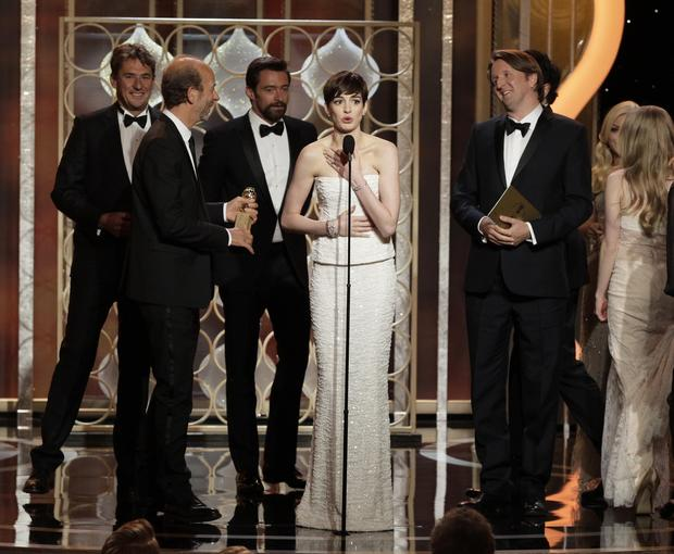 "Anne Hathaway won her supporting actress Globe for ""Les Miserables"" and gave her by-now-standard super-sincere acceptance speech. But one spin at the microphone wasn't enough. When the film won in the comedy or musical category, she grabbed the mike once again to thank even more people, before even the producers of the movie could say a thing. Next time, perhaps she should take a cue from her hair and cut it short."