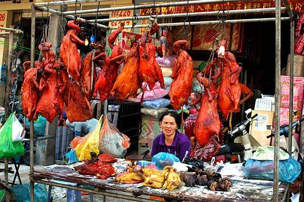 A woman sells roasted ducks at Siem Reap's night market.