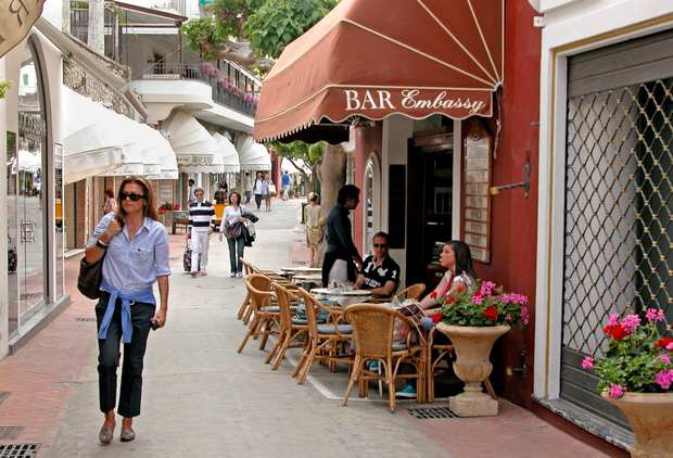 "Shops and cafes in the heart of Capri town cater to affluent tastes. ""Everything's expensive in Capri,"" a local says."