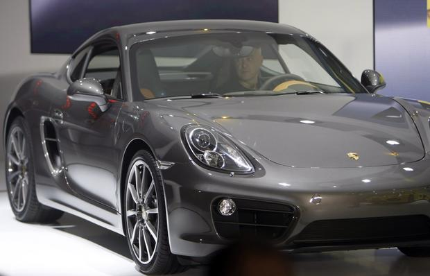 "Porsche introduces the new Cayman.<br><b>More: </b><a href=""http://www.latimes.com/business/autos/la-fi-hy-autos-laas-porsche-cayman-world-debut-20121128,0,1300100.story"" target=""_blank"">$54,000 for Porsche Cayman base model; price zooms from there</a>"