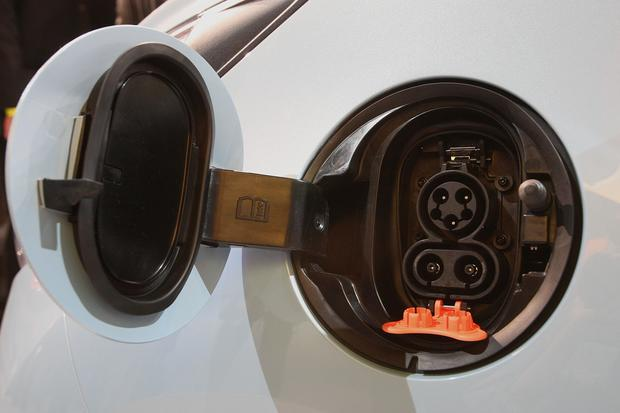 The 2013 Chevrolet Spark EV's connection for fast charging is shown.