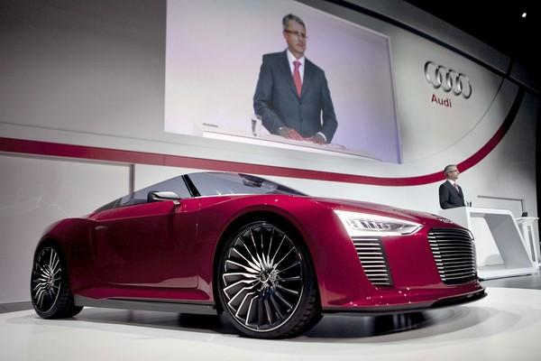 Rupert Stadler, chief executive of Audi, speaks next to an Audi R8 Spyder sports car during his keynote speech at the Consumer Electronics Show.