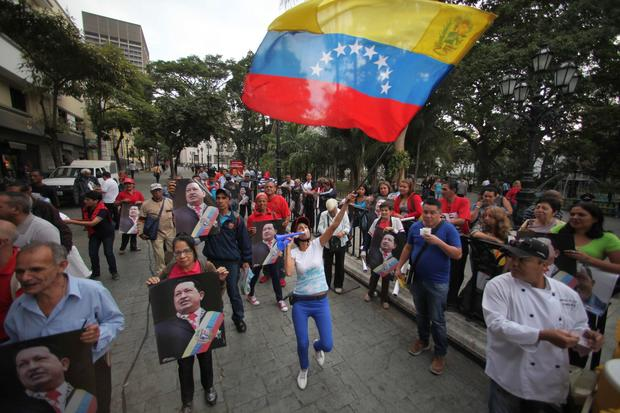 Supporters of Venezuela's President Hugo Chavez celebrate his return to the country at Bolivar Square in Caracas.