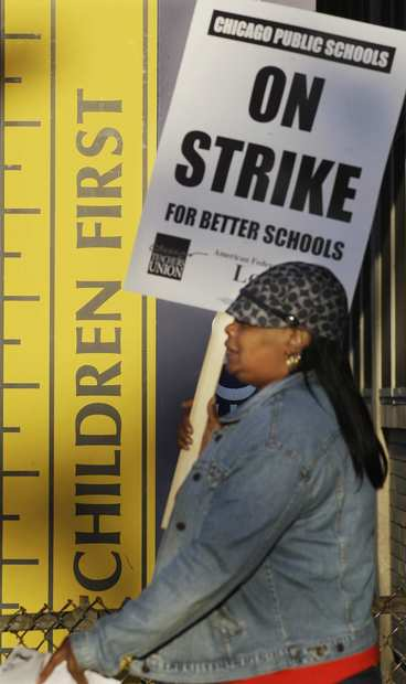 Chicago teacher Alma Hill walks a picket line outside Benjamin Banneker Elementary School in Chicago.