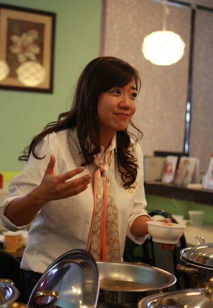 Nicole Huang, owner of Jing Mommy in Walnut, serves up a bowl of mountain yam to expectant mothers attending a tasting party.