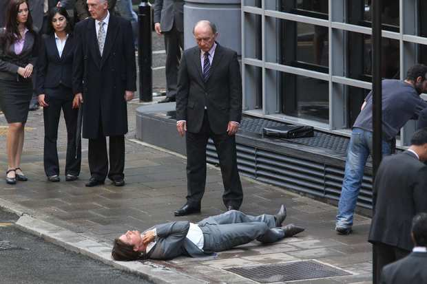 "Brad Pitt's body double is stretched out on the sidewalk on the set of ""The Counselor"" in London."
