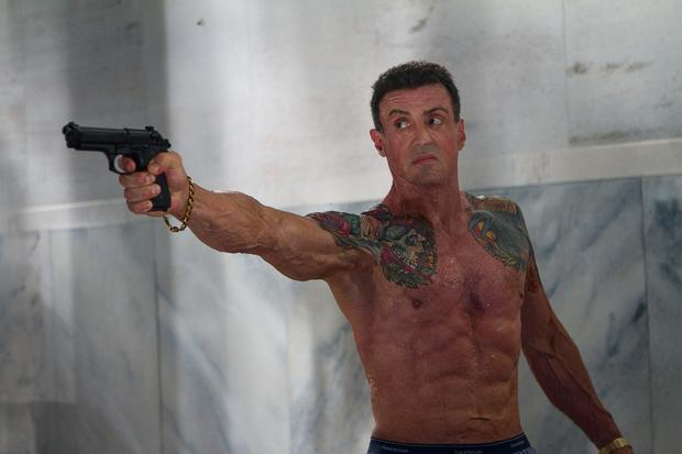 Jimmy Bobo (Sylvester Stallone, no stranger to gripping guns from his Rambo days) wields a Berettta 92FS, according to IMFDB.org.
