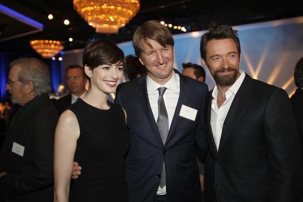 """Les Miserables"" supporting actress nominee Anne Hathaway, director Tom Hooper and lead actor nominee Hugh Jackman."