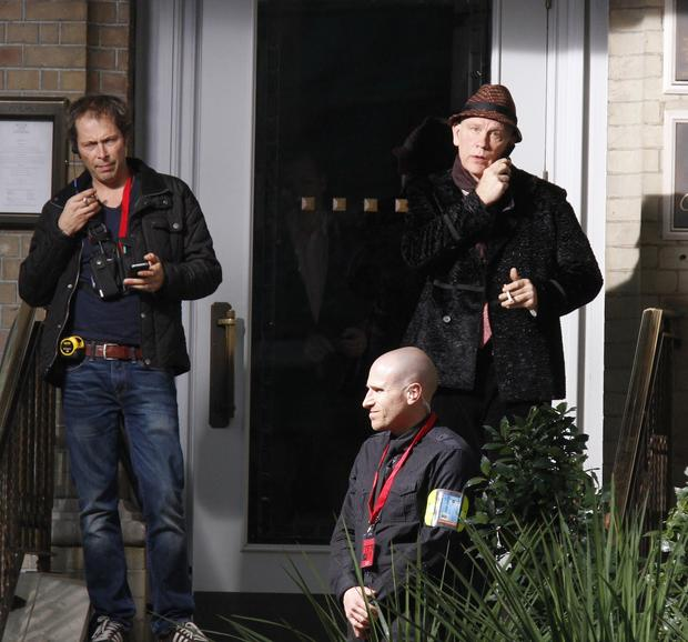 "John Malkovich, right, on location in London for ""Red 2."""