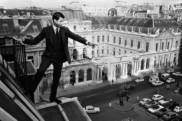 "George Hamilton walks on the roof of the Hotel Louvre during filming of ""Jack of Diamonds"" on  Oct. 17, 1966, in Paris."