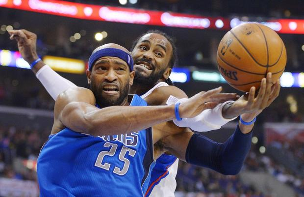 Clippers power forward Ronny Turiaf tries to beat Mavericks forward Vince Carter for a rebound in the first half Wednesday night.