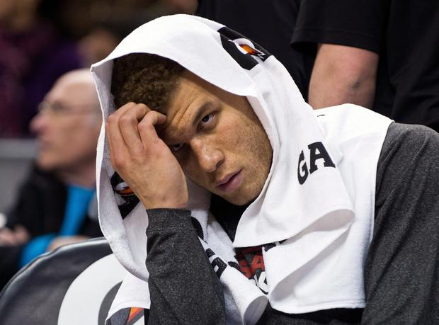 Clippers power forward Blake Griffin watches from the bench as the Raptors pull away for a 98-73 victory on Friday night in Toronto.