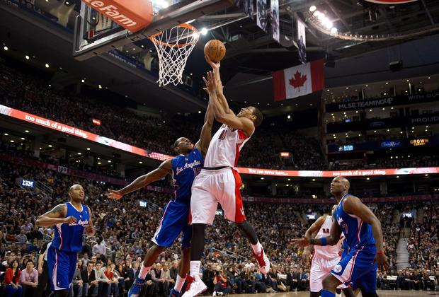 Clippers point guard Eric Bledsoe challenges a shot by Raptors guard DeMar DeRozan in the second half Friday night.