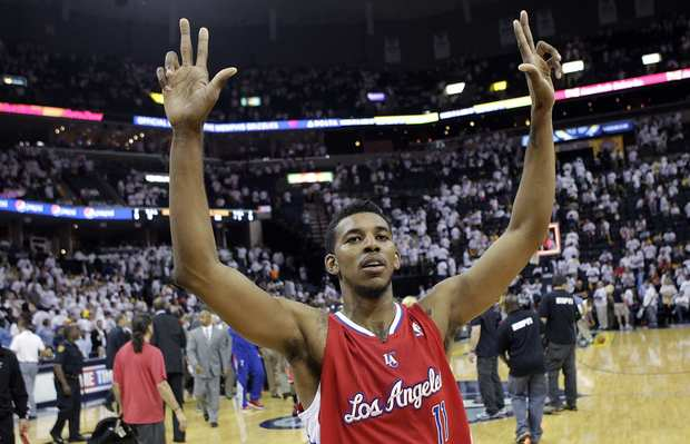 Guard Nick Young celebrates after the Clippers upset the Grizzlies, 82-72, in Game 7 of their first-round playoff series on Sunday afternoon in Memphis.