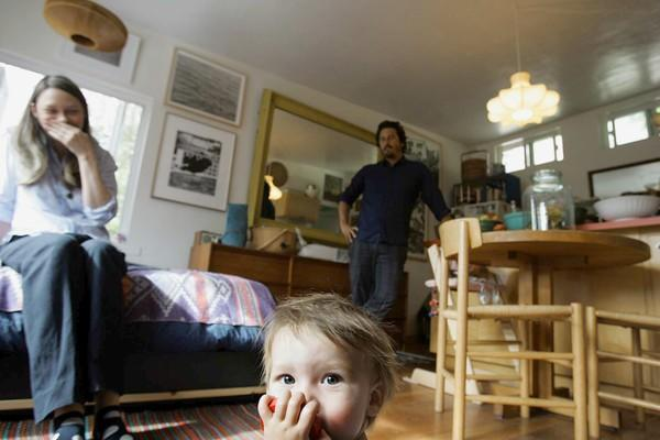 "By David A. Keeps<br> <br> A lot of families start out in small houses – just not <i>this</i> small. Kelly Breslin, Ryan Conder and their 9-month-old son, Thurston, live in a 380-square-foot 1950s house in Echo Park with living quarters built above the garage. The family also makes room for a mutt named Charlie. Conder and Breslin insist they prefer living small and don't let it cramp their style. The space is arranged for maximum efficiency but maintains the vibe of an artist's loft with a carefully edited selection of contemporary art and midcentury Danish and Italian furniture.<br> <br> We recently dropped in on Breslin and Conder, owner of the men's clothing store <a href=""http://www.southwillard.com/""> <u>South Willard</u></a>. It wasn't an exhausting tour -- you're looking at about half of their home here -- but their designs for living (and parenting) were eye-opening."