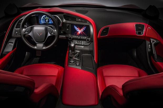 "The 2014 Corvette Stingray's interior will include carbon fiber, aluminum and hand-wrapped leather trim pieces, and two 8-inch configurable ""infotainment"" screens."