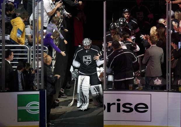 Kings goalie Jonathan Quick heads out onto the ice before the start of Tuesday's playoff game against the Phoenix Coyotes.