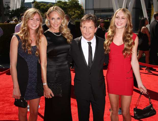 Michael J. Fox and his wife, Tracy Pollan, second from left, and family attend.