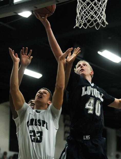 Cubs center Thomas Welsh gets to a rebound before the Celts' Aaron Lacombe on Friday night.