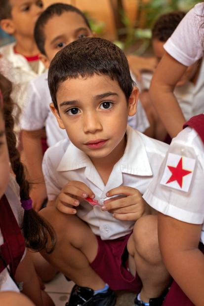 A young student attending the Escuela Primaria Angela Landa in Havana waits for his teacher.