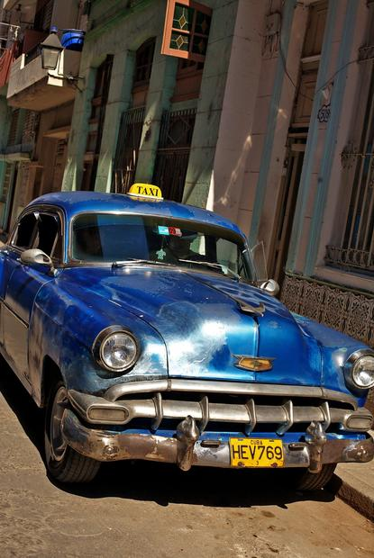 An old Chevrolet has been converted into a taxi cab.