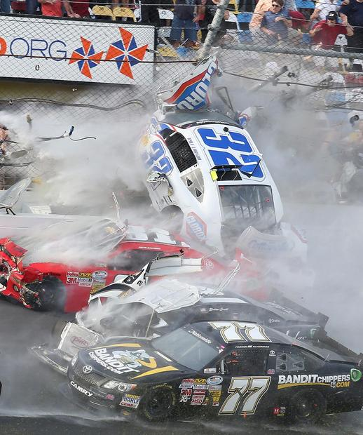 The car of Nationwide Series driver Kyle Larson begins to go airborne after a chain-reaction crash involving several cars on the last lap of the NASCAR race on Saturday at Daytona International Speedway.