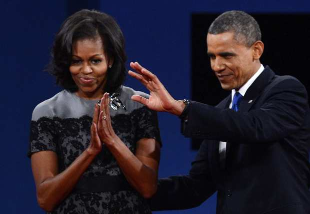 First Lady Michelle Obama joins President Obama onstage after the debate.