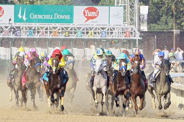 The 138th Kentucky Derby field breaks down the front stretch at the start of the race Saturday at Churchill Downs in Louisville.