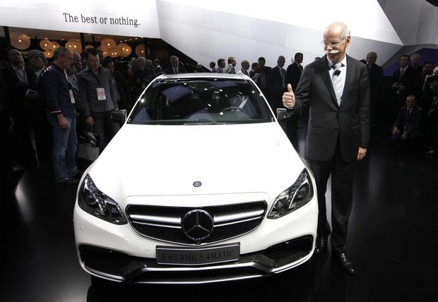 Dieter Zetsche of Mercedes-Benz Cars gives a thumbs-up at the debut of the 2014 E 63 AMG S 4matic.
