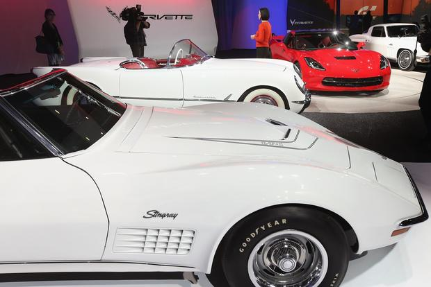Several generations of Chevrolet Corvettes are displayed during the media preview.