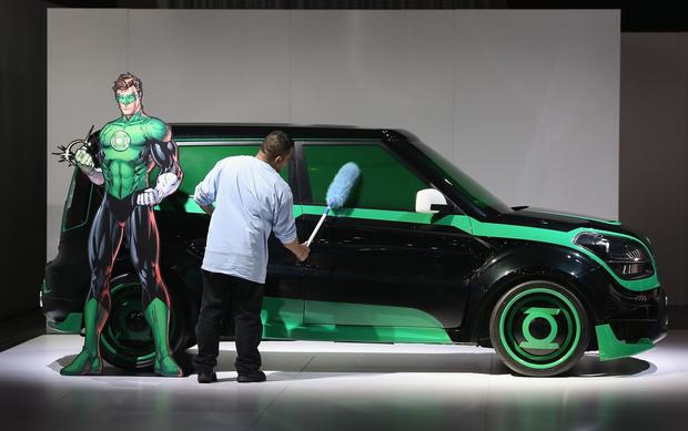 Angel Palizio dusts a Kia Soul with the DC Comics package during the media preview.