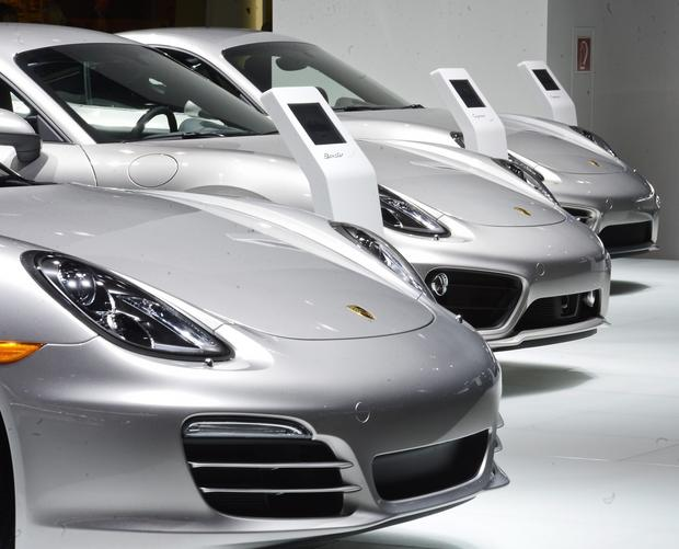 The front end of Porsche Boxter, left, Porsche Cayman S, center, and the Porsche Cayman are on display during the media preview.