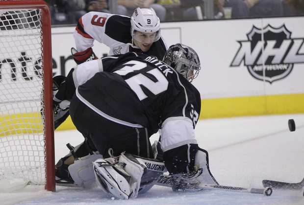 Kings goalie Jonathan Quick blocks a shot by New Jersey forward Zach Parise during the Kings' 4-0 victory in Game 3 of the Stanley Cup Final at Staples Center.