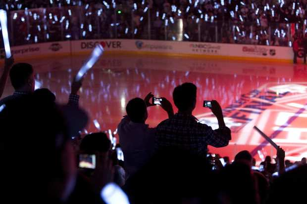 Fans wave glow sticks and snap photographs before the start of Game 3 of the Stanley Cup Final between the Kings and New Jersey Devils at Staples Center on Monday.
