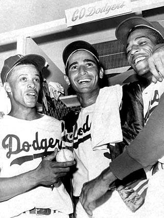 From left, Dodgers Maury Wills, Sandy Koufax and Willie Davis celebrate after Game 5 of the 1965 World Series, in which Koufax pitched a four-hit shutout, winning, 7-0. After Minnesota tied the series by winning Game 6, Koufax returned on two days' rest to win Game 7.