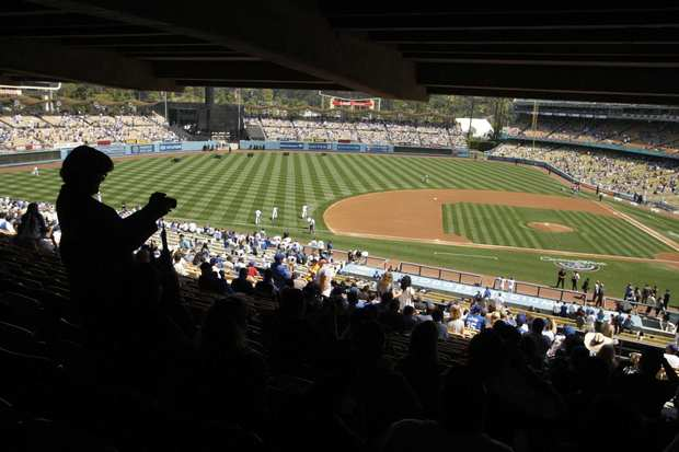 A baseball fan takes a picture of the field at Dodger Stadium before the start of Tuesday's home opener against the Pittsburgh Pirates.