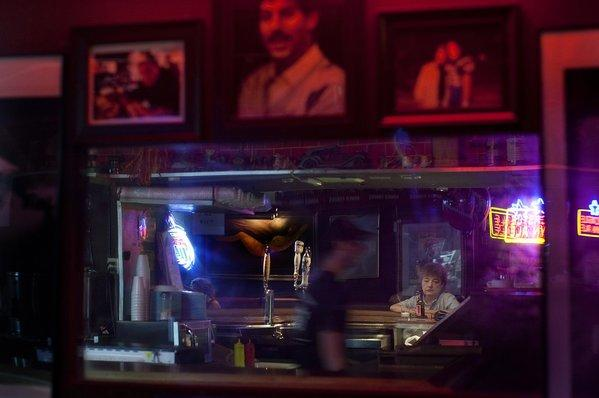 King Eddy Saloon, one of the last low-cost bars on skid row, is being taken over by new management. The regular patrons hope it doesn't lose its old-time charm.