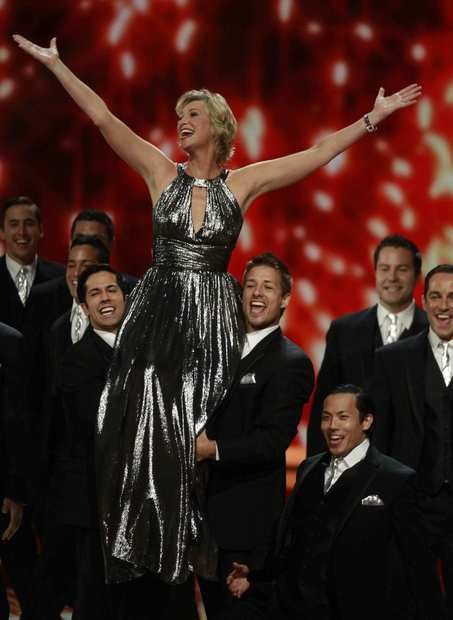 """Glee's"" Jane Lynch doesn't get to sing much on her show, so it wasn't a surprise that Fox would have her cut loose with an opening song-and-dance number. It's an awards show staple, and Lynch traversed sets with the best of 'em, trading barbs with the boys of ""The Big Bang Theory,"" poking fun at the 20-something high schoolers of ""Friday Night Lights"" and getting in a tense conversation with the cast of ""Mad Men.""<br> <br> Though it was a bit odd to see the fourth wall of such a serious show ripped down, Lynch and Jon Hamm made it work. Lynch was from the future, poisoning the thoughts of the patriarchal advertising setting of ""Mad Men"" with talks of gay marriage and digital recorders that allow audiences to -- gasp -- skip the commercials.<br> <br> <b>RELATED:</b><br> <br> - <a href=""http://theenvelope.latimes.com/galleries/photo/emmys/la-env-emmy-awards-red-carpet-pictures,0,1059351.photogallery"">The 2011 Emmy Awards 