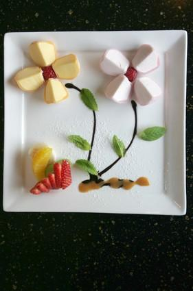 Part of the <i>omakase</i> menu: mochi ice cream is presented in the shape of flowers at Kiwami in Studio City.