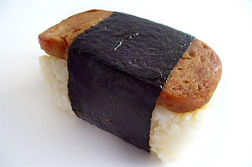 <i>Descriptions by Betty Shimabukuro, Special to The Los Angeles Times</i><br> <br> <b>Spam musubi</b>: People from the mainland are  often amused  by Hawaiians' affinity for Spam. But do not mock us.  We're on to something. For proof, sample the No. 1 picnic food: Spam <i>musubi</i>.<br> <br> <i>Musubi</i> is a Japanese rice ball -- triangular and wrapped in a strip of <i>nori</i>, or roasted seaweed. Spam <i>musubi</i> is brick-like: rice on the bottom, a slab of Spam on top. It's salty, like Spam, but the rice absorbs the greasiness, and the seaweed wrapper provides that bit of <i>umami</i>.<br> <br> It's a favorite at picnics and at the 19th hole on the golf course. Soccer moms make them by the dozens for post-game snacks.<br> <br> Acrylic molds are widely available for shaping the rice, but you can buy  servings of Spam <i>musubi </i>ready-made for less than $2 at convenience stores or in the deli section of supermarkets.