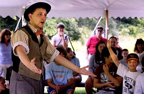 "Nick Lorentz engages the crowd as a Civil War-era newspaper reporter. He's part of the Gettysburg museum's ""A Visit to the Past"" program."