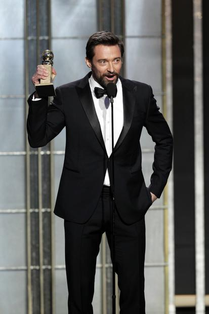"Hugh Jackman accepts the Golden Globe for actor in a comedy or musical for his performance in ""Les Misérables.""<br><br>