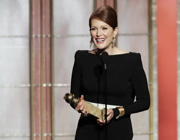 "Julianne Moore accepts the Golden Globe for actress in a miniseries or TV movie for her role as Sarah Palin in ""Game Change.""<br><br>