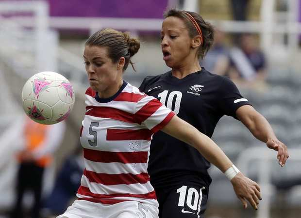 Kelley O'Hara, left, of the U.S. fights for the ball with New Zealand's Sarah Gregorius during their quarterfinal soccer match at the St. James' Park in Newcastle.