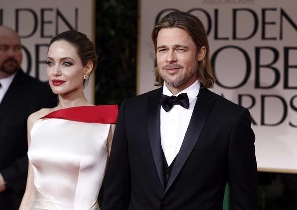 "Breaking! Brad Pitt walked around and -- get this -- opened the limo door for Angelina Jolie! This was actually a point of conversation between the E! red carpet pre-show hosts.  But did he smile at her? E! hosts did not say. Expect an in-depth ""Frontline""-style E! special soon to find out the answer to this."