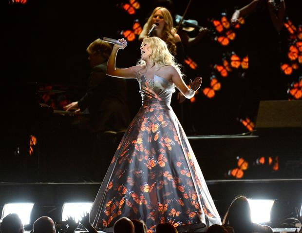 "We're all for experimentation and boundary pushing in our live music performances, but Carrie Underwood was surely steered wrong by someone when they suggested she stand completely still during her performance while a variety of images and patterns were displayed on her large, flowing dress. Unless someone was planning to project ""Lincoln"" on there, they shouldn't have bothered."