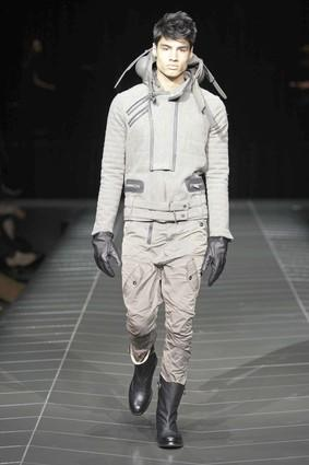 The waves of gray that flooded the European men's runways earlier this season are now lapping at our shores, and the result is a steely crop of men's suits and sportswear. But that hardly meant dull. Labels including Diesel Black Gold, Calvin Klein, G-Star Raw (pictured) and Monarchy Collection served up Prince of Wales checks, herringbones and color-blocked shades of charcoal, iron and smoke.<br> <br> Band of Outsiders matched its shades-of-gray patchwork suit with color-blocked gray wool flannel boat shoes, its newest collaboration with Sperry Top-Sider.<br> <br> <i>— Adam Tschorn</i><br> <br> <b>More in Image:</b><br>