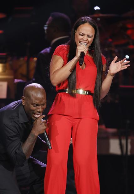 Singers Tyrese, left, and Elle Varner perform during the Grammys pre-telecast show.