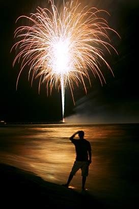 Fireworks brighten the sky above the Gulf of Mexico.