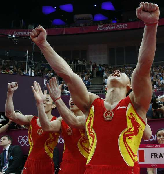 China's team celebrates at the men's team final of the artistic gymnastics.